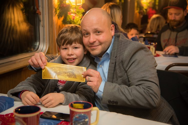 Mason and Dad Diego on The Polar Express with Kids Cancer Care.